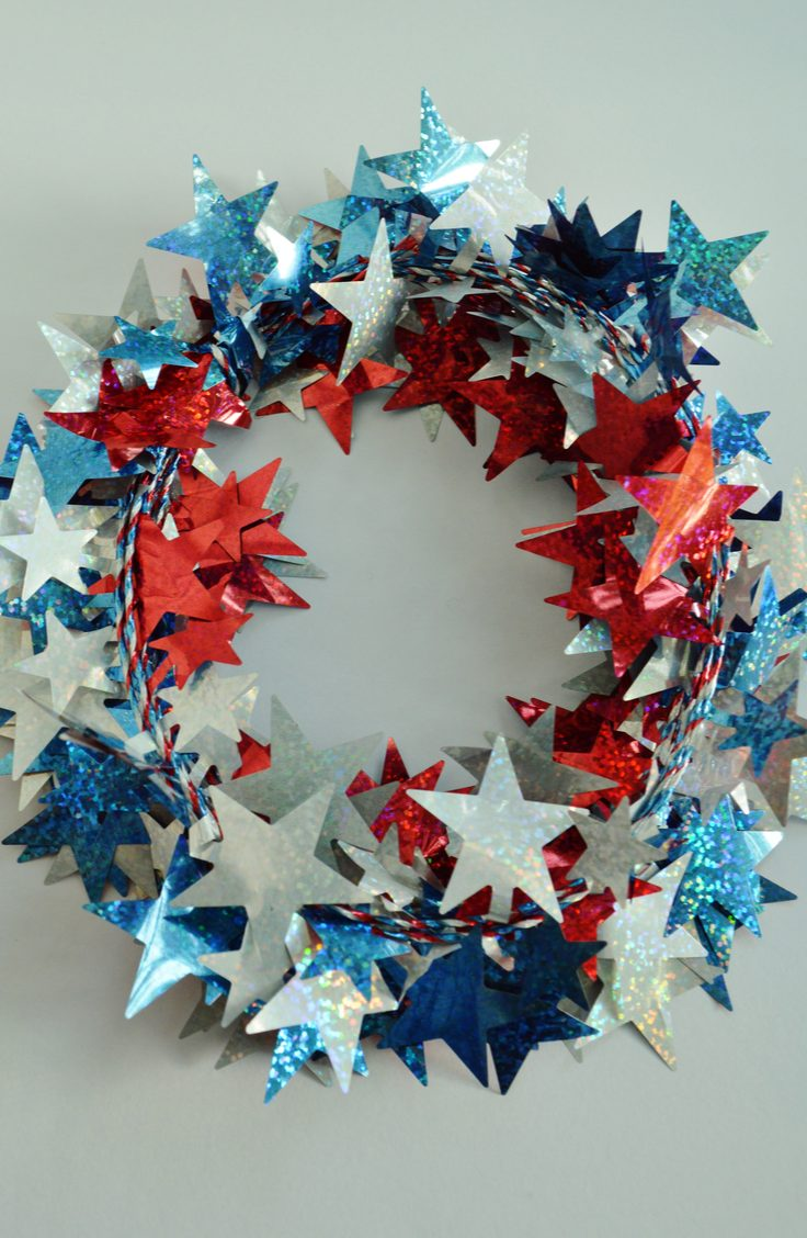 Make your door a shining star this summer with an easy wreath made with glittery star garland. Here are some darling ideas for 4th of July DIY door wreaths. You will love them!