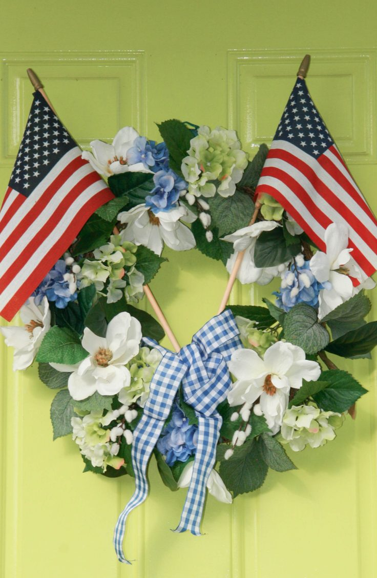 Add some pretty flowers to a basic green wreath to give your door some patriotic flower power. Here are some darling ideas for 4th of July DIY door wreaths. You will love them!