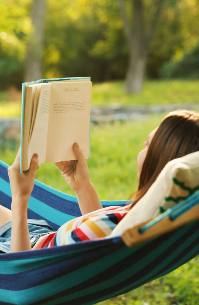 Want to read a book outside but don't have a place to sit and relax? The summer heat can be beat with a DIY hammock stand! Check it out!