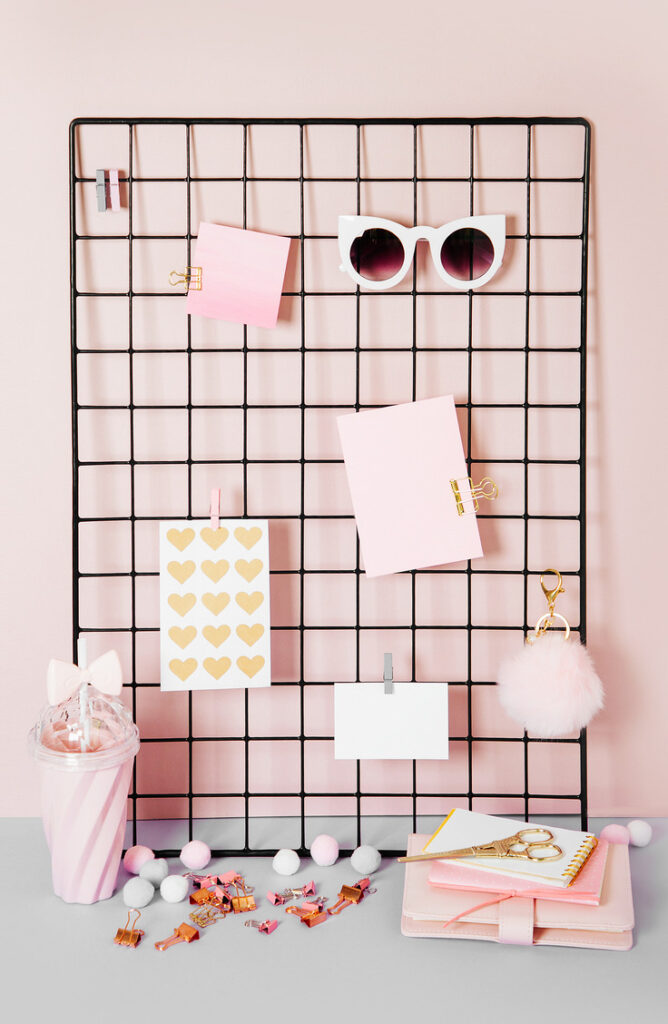 You've printed your fav photos, now what? When it comes to finding ways to display photos, there are so many options! Try a cute wire wall grid and some clothespins for a fun and creative way to display your photos.