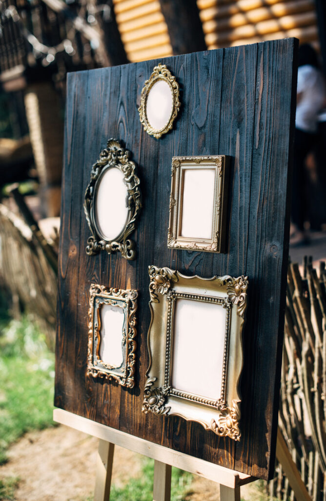You've printed your fav photos, now what? When it comes to finding ways to display photos, there are so many options! We love the look of this easel paired with multiple vintage frames! Scavenge your local thrift store to find ornate frames and then mount them on a stained board for a beautiful photo collage. To create unity where you've got multiple frame styles, try painting them all the same color!