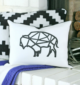 Create Any Shape You Want Out Of Leather Or Any Durable Material And Stitch  Onto A Throw Pillow.