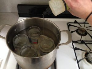Boil jars in water to remove labels from jars.