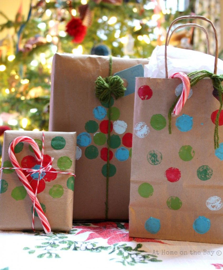 I know it might sound crazy, but for Christmas this year, try a paper sack gift bag. They are easy to decorate however you want and they are easy to make.