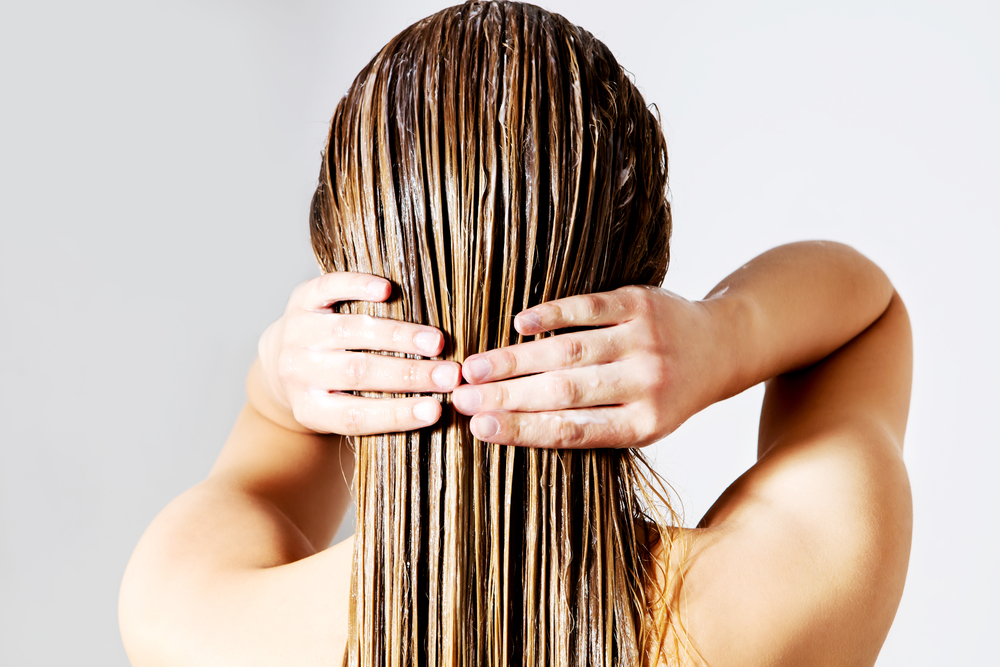 What is the process of co-washing hair?